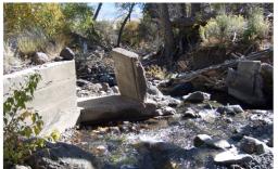 Broken Weir In Blown-Out Ditch